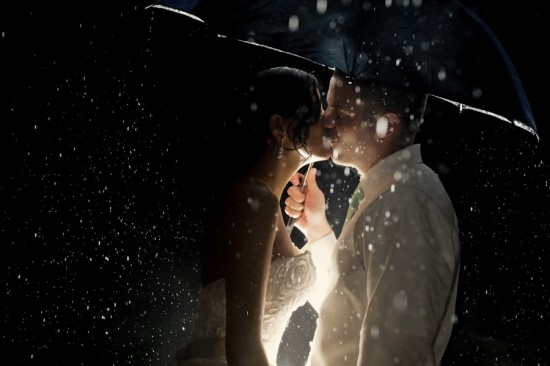 bride-and-groom-kissing-in-the-rain-550x366